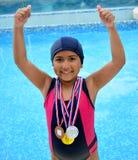 Flicka i baddräkt med medaljer Arkivbild