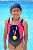 Flicka i baddräkt med medaljer Fotografering för Bildbyråer