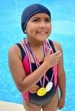 Flicka i baddräkt med medaljer Royaltyfri Fotografi