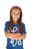 Flicka i blå skjorta med hennes vikta armar Royaltyfri Fotografi