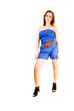 Flicka i blåa kortslutningar. Royaltyfria Foton