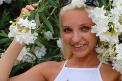 Flicka i blommor Royaltyfria Bilder