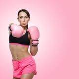 Flicka i boxninghandskar Royaltyfri Foto