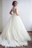 Flicka i bröllopsklänning Arkivfoto