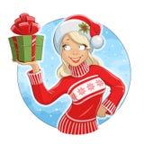 Flicka i den Santa Claus dräkten med gåvaasken Arkivbild