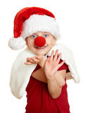 Flicka i den santa hatten med clownnäsan på isolerad vit Fotografering för Bildbyråer