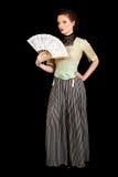Flicka i den viktorianska klänningen som vinkar en fan Royaltyfri Bild