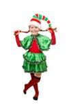 Flicka i dräkt av julälvan Royaltyfri Foto