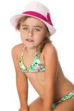 flicka i en baddräkt och en hatt Fotografering för Bildbyråer