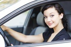 Flicka i en bil Arkivfoton
