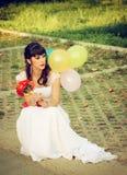Flicka i en bröllopsklänning Fotografering för Bildbyråer