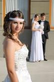Flicka i en bröllopsklänning Arkivbild