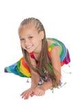 Flicka i en färgrik klänning Royaltyfri Foto