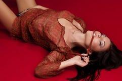 Flicka i en röd klänning Arkivfoto