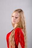 Flicka i en röd klänning Royaltyfria Foton