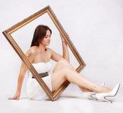 Flicka i en ram Royaltyfri Bild