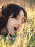 Flicka i en sätta in av blommor royaltyfria foton