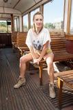 Flicka i en spårvagn royaltyfri foto