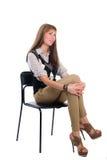 Flicka i en stol Arkivfoto