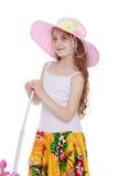 Flicka i en sugrörhatt arkivbild
