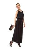Flicka i en svart retro klänning Arkivbild
