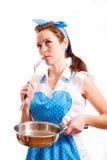 Flicka i ett blått förkläde Royaltyfri Fotografi