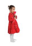 Flicka i ett rött klänninginnehav en klubba Royaltyfria Foton