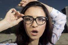 Flicka i exponeringsglas Arkivbild