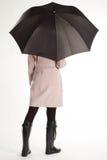 Flicka i gummistöveler och paraply Royaltyfria Foton