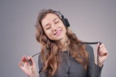 Flicka i hörlurar Fotografering för Bildbyråer