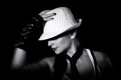 Flicka i hatt Arkivbild