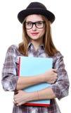 Flicka i hatt med böcker Royaltyfri Bild