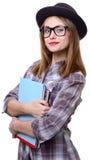 Flicka i hatt med böcker Arkivfoton