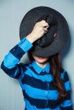 Flicka i hatten Royaltyfri Foto