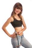 Flicka i jeans som mäter midjan Royaltyfria Foton