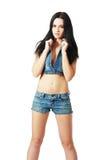 Flicka i jeanskortslutningar royaltyfria bilder