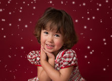 Flicka i jul klänning, dräkt med ljus och snöflingor Royaltyfria Bilder