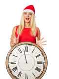 flicka i jultomten en hjälpredahatt och klockor Arkivbild