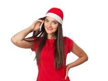 Flicka i jultomten en talande telefon för hjälpredahatt Royaltyfri Foto