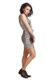 Flicka i klänningpaljetter isolate Fotografering för Bildbyråer