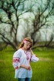 Flicka i nationell klänning Royaltyfria Foton