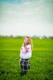 Flicka i nationell klänning Royaltyfri Foto
