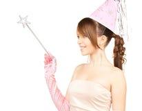 Flicka i partilock med den magiska pinnen Royaltyfria Bilder