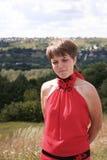 Flicka i rött Fotografering för Bildbyråer