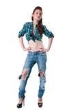 Flicka i riven sönder jeans Royaltyfri Bild