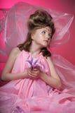 Flicka i rosa färger royaltyfria foton