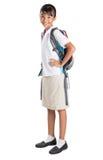 Flicka i skolalikformig och ryggsäck VI Arkivfoton