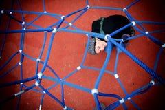 Flicka i spindels rengöringsduk Arkivbilder