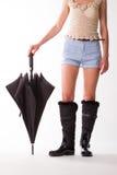 Flicka i svarta gummistöveler Royaltyfria Bilder