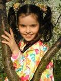 Flicka i trädgård Royaltyfri Foto